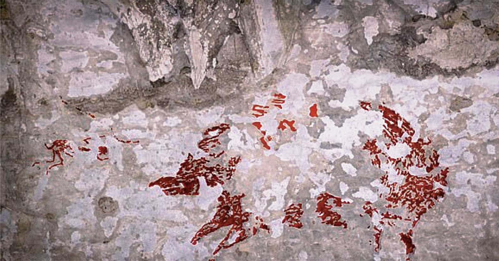 Indonesia sulawesi rock art human-like hunters fleeing mammals dated 44,000 years old cave art species