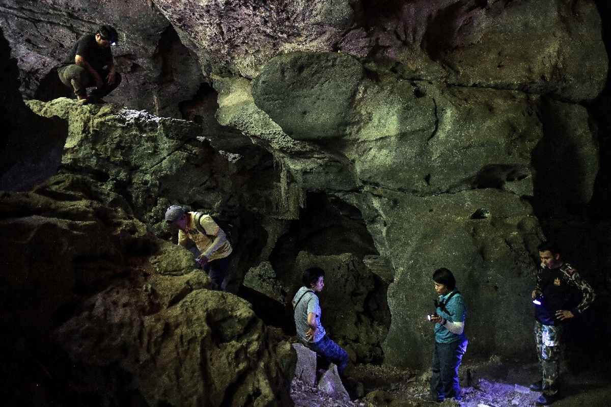 Thai archaeologists hunt ancient artwork cave paintings Thailand